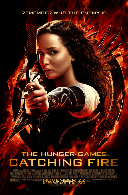 """Courtesy photo Katniss Everdeen fires a Hoyt Buffalo recurve bow with Easton X7 Cobalt arrows -- both manufactured in Salt Lake City -- on the movie poster for """"Catching Fire."""""""