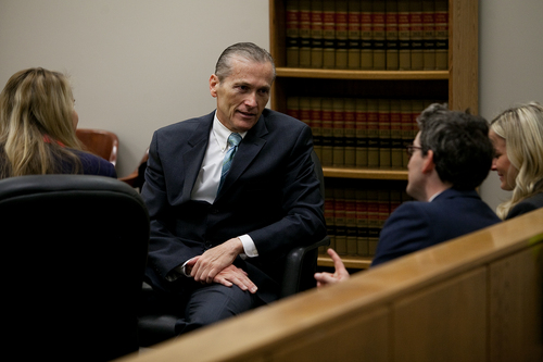 Mark Johnston  |  Pool Martin MacNeill sits with his defense counsel during a morning recess at 4th District Court in Provo Wednesday, Nov. 6, 2013. MacNeill is charged with murder for allegedly killing his wife Michele MacNeill in 2007.