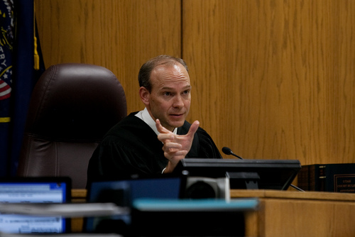 Mark Johnston  |  Pool Judge Derek Pullan reacts after unauthorized audio from a media outlet was heard in the courtroom from a device owned by the prosecution during the trial of Martin MacNeill at 4th District Court in Provo Wednesday, Nov. 6, 2013. MacNeill is charged with murder for allegedly killing his wife Michele MacNeill in 2007.