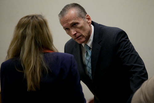 Mark Johnston  |  Pool Martin MacNeill speaks to his attorney Susanne Gustin during a recess at 4th District Court in Provo Wednesday, Nov. 6, 2013. MacNeill is charged with murder for allegedly killing his wife Michele MacNeill in 2007.