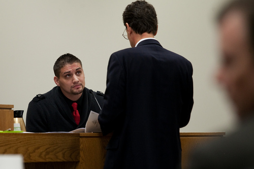 Mark Johnston  |  Pool  Defense attorney Randy Spencer, right, questions Jason Poirier, a former inmate who served time with Martin MacNeill, during MacNeill's trial at 4th District Court in Provo Wednesday, Nov. 6, 2013. MacNeill is charged with murder for allegedly killing his wife Michele MacNeill in 2007.