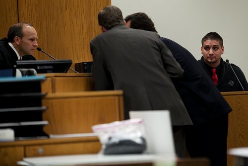 Mark Johnston  |  Pool  Jason Poirier, right, a former inmate who served time with Martin MacNeill, sits on the witness stand as Judge Derek Pullan speaks with attorneys during MacNeill's trial at 4th District Court in Provo Wednesday, Nov. 6, 2013. MacNeill is charged with murder for allegedly killing his wife Michele MacNeill in 2007.
