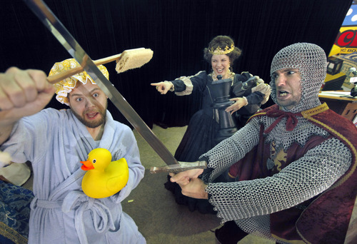 From left,  B.J. Scanlon, of Rochester, N.Y., Sarah Peters, of Pittsford, N.Y., and Shawn Gray, of Henrietta, N.Y., stage a fight during the National Toy Hall of Fame ceremony at the National Museum of Play at The Strong in Rochester, N.Y., Thursday, Nov. 7, 2013. The rubber duck and the ancient game of chess were inducted into the Toy Hall of Fame Thursday, beating out 10 other finalists including bubbles, the board game Clue, and Nerf toys. (AP Photo/Democrat & Chronicle, Carlos Ortiz)  MAGS OUT; NO SALES