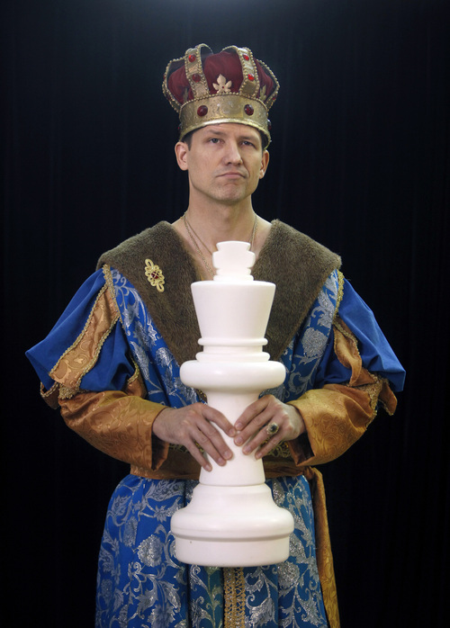 Michael Fisher, of Pittsford, N.Y., holds an oversized chess piece during the National Toy Hall of Fame ceremony at the National Museum of Play at The Strong in Rochester, N.Y., Thursday, Nov. 7, 2013. The rubber duck and the ancient game of chess were inducted into the Toy Hall of Fame Thursday, beating out 10 other finalists including bubbles, the board game Clue, and Nerf toys. (AP Photo/Democrat & Chronicle, Carlos Ortiz)  MAGS OUT; NO SALES
