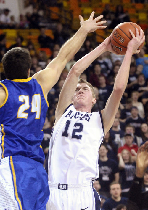 Utah State's Danny Berger (12) looks to shoot past California-Santa Barbara's Christian Peterson (24)  during the first half of an NCAA college basketball game at in Logan, Utah, on Saturday, Feb. 18, 2012. (AP Photo/The Herald Journal, Jennifer Meyers)