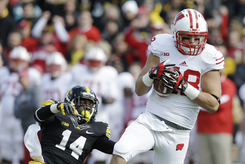 Wisconsin tight end Jacob Pedersen catches a 44-yard touchdown pass over Iowa defensive back Desmond King, left, during the first half of an NCAA college football game, Saturday, Nov. 2, 2013, in Iowa City, Iowa. (AP Photo/Charlie Neibergall)