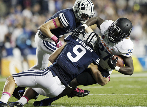 Boise State's Jay Ajayi is tackled by BYU's Daniel Sorensen during an NCAA college football game, Friday, Oct. 25, 2013 at LaVell Edwards Stadium in Provo, Utah. (AP Photo/The Daily Herald, Mark Johnston)