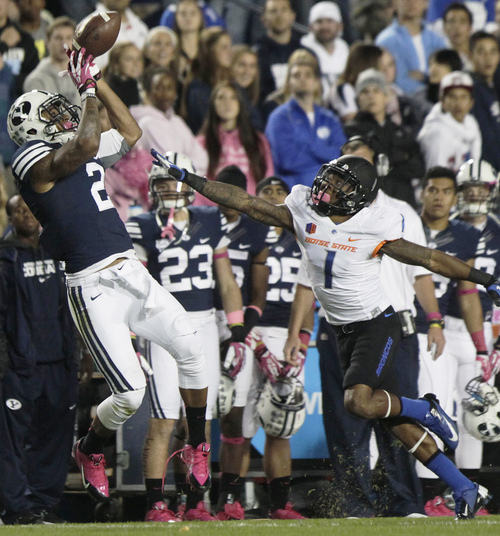 BYU's Cody Hoffman juggles and pulls in a pass over Boise State's Bryan Douglas during an NCAA college football game, Friday, Oct. 25, 2013 at LaVell Edwards Stadium in Provo, Utah. (AP Photo/The Daily Herald, Mark Johnston)