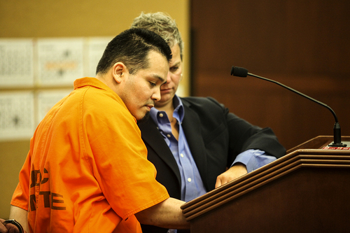 Dylan Brown | Pool photo by Standard-Examiner Daniel Rivera signs his name, agreeing on the manslaughter and desecration of a human body charges, Wednesday, Sept. 25, 2013 in Judge Ernie Jones's courtroom in Ogden.
