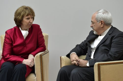 EU High Representative for Foreign Affairs Catherine Ashton, left, speaks with Iranian Foreign Minister Mohammed Javad Zarif, right, during a photo opportunity prior the start of two days of closed-door nuclear talks at the United Nations offices in Geneva Switzerland, Thursday, Nov. 7, 2013. Six world powers are dangling the prospect of easing some sanctions against Iran if Tehran agrees to curb work that could be used to make nuclear weapons. Talks resume Thursday between Iran and the six _ The United States, Russia, China, Britain, France and Germany. (AP Photo/Keystone, Martial Trezzini)