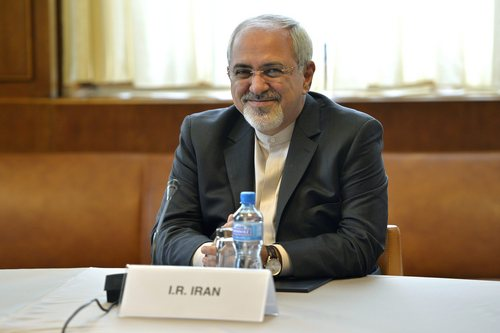 Iranian Foreign Minister Mohammed Javad Zarif waits for the start of two days of closed-door nuclear talks at the United Nations offices in Geneva Switzerland, Thursday, Nov. 7, 2013. Six world powers are dangling the prospect of easing some sanctions against Iran if Tehran agrees to curb work that could be used to make nuclear weapons. Talks resume Thursday between Iran and the six _ The United States, Russia, China, Britain, France and Germany. (AP Photo/Keystone, Martial Trezzini)