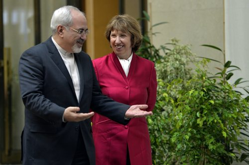 EU High Representative for Foreign Affairs Catherine Ashton, right, walks next to Iranian Foreign Minister Mohammed Javad Zarif, left, during a photo opportunity prior to the start of two days of closed-door nuclear talks at the United Nations offices in Geneva Switzerland, Thursday, Nov. 7, 2013. Six world powers are dangling the prospect of easing some sanctions against Iran if Tehran agrees to curb work that could be used to make nuclear weapons. Talks resume Thursday between Iran and the six _ The United States, Russia, China, Britain, France and Germany. (AP Photo/Keystone, Martial Trezzini)