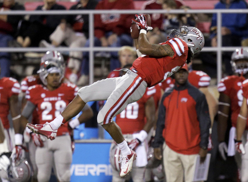 UNLV wide receiver Devante Davis catches a pass for a first down against Utah State in the first quarter of an NCAA college football game Saturday, Nov. 9, 2013, in Las Vegas. (AP Photo/Julie Jacobson)