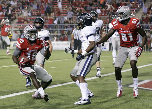 UNLV wide receiver Marcus Sullivan (18) crosses the goal line for a touchdown against Utah State in the first quarter of an NCAA college football game Saturday, Nov. 9, 2013, in Las Vegas. (AP Photo/Julie Jacobson)