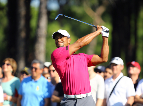 Tiger Woods of the U.S tees off during the third round of the Turkish Open golf tournament at the Montgomerie Maxx Royal Course in Antalya, Turkey, Saturday, Nov. 9, 2013. (AP Photo/Kaan Soyturk)