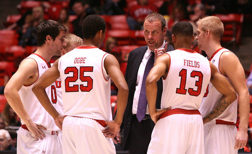 Leah Hogsten     The Salt Lake Tribune Utah Utes head coach Larry Krystkowiak    directs his charges in the second half. University of Utah defeated Evergreen State 128-44 Friday, November 8, 2013 at the Huntsman Center.
