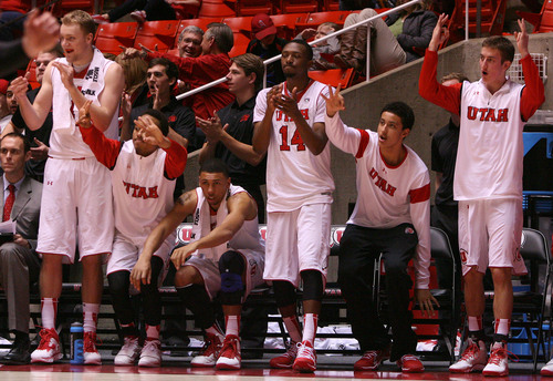Leah Hogsten  |  The Salt Lake Tribune Utah Utes starters cheered on their teammates for a 3-pointer during the second half.  University of Utah defeated Evergreen State 128-44 Friday, November 8, 2013 at the Huntsman Center.