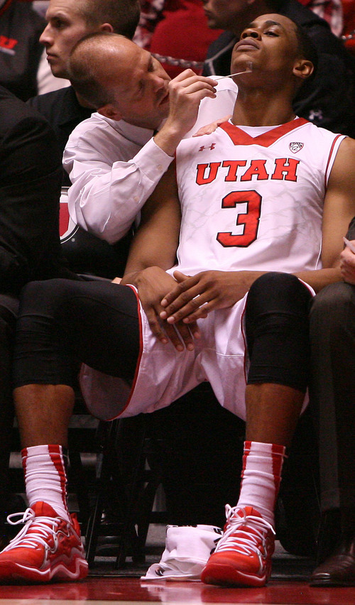 Leah Hogsten     The Salt Lake Tribune Utah Utes guard/forward Princeton Onwas (3) gets his bloody chin tended to during the second half. University of Utah defeated Evergreen State 128-44 Friday, November 8, 2013 at the Huntsman Center.