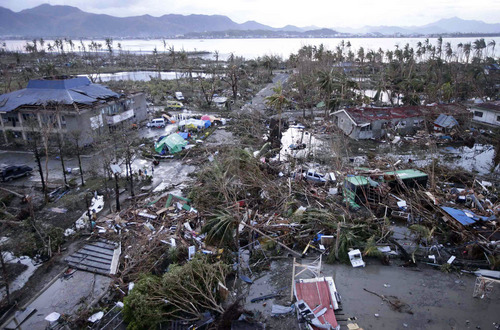 Tacloban Airport is covered by debris after powerful Typhoon Haiyan hit Tacloban city, in Leyte province in central Philippines, Saturday, Nov. 9, 2013. Rescuers in the central Philippines counted at least 100 people dead and many more injured Saturday, a day after one of the most powerful typhoons on record ripped through the region, wiping away buildings and leveling seaside homes with massive storm surges. (AP Photo/Bullit Marquez)