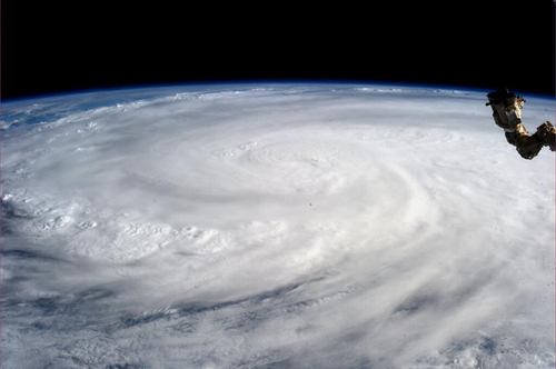 This image provided by NASA shows Typhoon Haiyan taken by Astronaut Karen L. Nyberg aboard the Internatioal Space Station Saturday Nov. 9, 2013. Rescuers in the central Philippines counted at least 100 dead and many more injured Saturday a day after one of the most powerful typhoons on record ripped through the region, wiping away buildings and leveling seaside homes in massive storm surges, then headed for Vietnam. (AP Photo/NASA, Karen L. Nyberg)