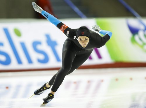 Heather Richardson, of the United States, during the women's 1000-meter competition at the World Cup speed skating event in Calgary, Alberta, Sunday, Nov. 10, 2013. (AP Photo/The Canadian Press, Jeff McIntosh)