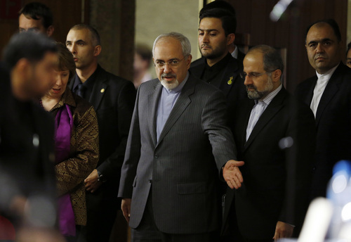 Catherine Ashton, the European Union's foreign policy chief, second from left, and Iranian Foreign Minister Mohammad Javad Zarif, center, arrive at a press conference at the end of the Iranian nuclear talks in Geneva, Sunday, Nov. 10, 2013. The European Union's top diplomat and Iran's foreign minister said nuclear talks between six world powers and Tehran did not seal a deal.  (AP Photo/Jason Reed, Pool)