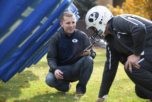 | Courtesy BYU BYU student Jake Merrell tests his helmet smartfoam product with a football player.