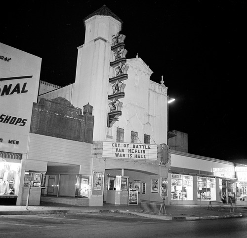 FILE - This Nov. 22, 1963 file photo shows the movie theater where Lee Harvey Oswald was arrested after U.S. President John F. Kennedy was shot and killed in Dallas. The Warren Commission said Oswald left the book depository moments after shots were fired from the sixth floor, returned by bus and cab to his rooming house, then ventured out again _ soon encountering a Dallas police officer who stopped him based on descriptions of the assassination suspect. According to the commission, Oswald fatally shot Patrolman J.D. Tippit with a handgun, then fled into the nearby movie theater. (AP Photo)
