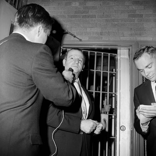 FILE - In this Jan. 28, 1964 file photo, Jack Ruby talks to a reporter while being returned to jail after a psychiatric examination in Dallas. As Lee Harvey Oswald was being transferred from police headquarters to the county jail on Nov. 24, 1963, Ruby shot him in the chest from close range. Ruby was convicted of murder and sentenced to death. He appealed and was granted a new trial, but died of lung cancer before a trial date was set. (AP Photo/Ferd Kaufman)