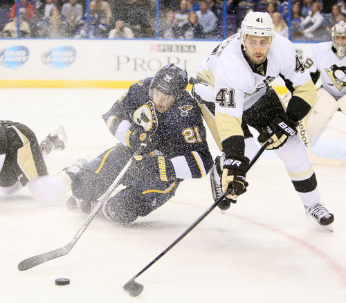 St. Louis Blues center Patrik Berglund, left, competes for the puck against Pittsburgh Penguins defenseman Robert Bortuzzo in first-period NHL hockey game action on Saturday, Nov. 9, 2013, in St. Louis.  (AP Photo/St. Louis Post-Dispatch, Chris Lee) EDWARDSVILLE OUT ; ALTON OUT