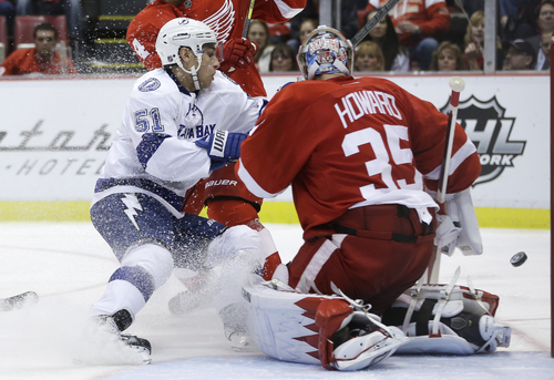 Tampa Bay Lightning center Valtteri Filppula (51), of Finland, has his shot deflected by Detroit Red Wings goalie Jimmy Howard (35) during the second period of an NHL hockey game in Detroit, Saturday, Nov. 9, 2013. (AP Photo/Carlos Osorio)
