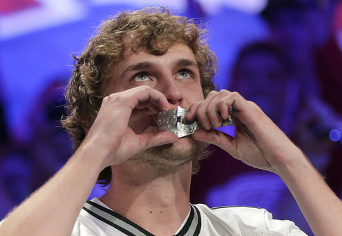Ryan Riess kisses the championship bracelet after defeating Jay Farber for the $8.4 million payout in the World Series of Poker Final Table, Tuesday, Nov. 5, 2013, in Las Vegas. (AP Photo/Julie Jacobson)