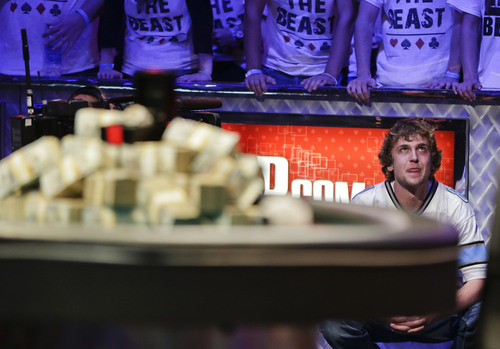 Ryan Riess watches as the dealer draws the river card on what was the last hand of the World Series of Poker Final Table against Jay Farber, Tuesday, Nov. 5, 2013, in Las Vegas.  Riess won a first place payout of $8.4 million. (AP Photo/Julie Jacobson)