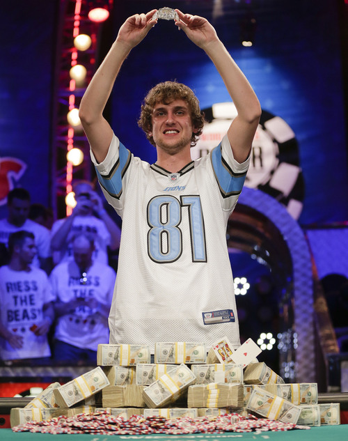 Ryan Riess holds up the championship bracelet after defeating Jay Farber for the $8.4 million payout in the World Series of Poker Final Table, Tuesday, Nov. 5, 2013, in Las Vegas. (AP Photo/Julie Jacobson)
