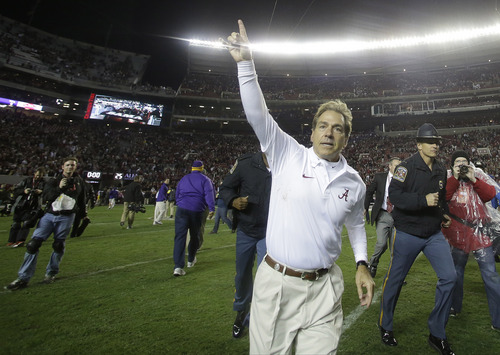 Alabama head coach Nick Saban runs off the field after the second half of an NCAA college football game against LSU, Saturday, Nov. 9, 2013, in Tuscaloosa, Ala. Alabama won 38-17. (AP Photo/Butch Dill)