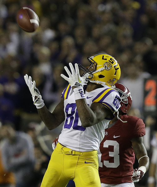 LSU wide receiver Jarvis Landry (80) makes the catch against Alabama defensive back Deion Belue (13) during the first half of an NCAA college football game, Saturday, Nov. 9, 2013, in Tuscaloosa, Ala. (AP Photo/Butch Dill)