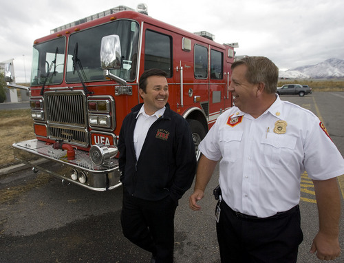 Al Hartmann  |  Tribune file photo Firefighers have made 13 trips to the Utah Data Center so far in 2013, according to records. Unified Fire Authority Chief Michael Jensen, left, said that's not a surprise. Jensen is seen in this 2010 photo with Deputy Chief Gaylord Scott.