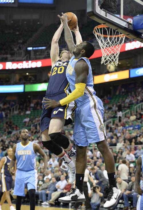 Rick Egan  | The Salt Lake Tribune   Utah Jazz shooting guard Gordon Hayward (20) goes up for a shot against Denver Nuggets power forward J.J. Hickson (7), in NBA action, Utah vs. The Denver Nuggets, in Salt Lake City, Monday, November 11, 2013.