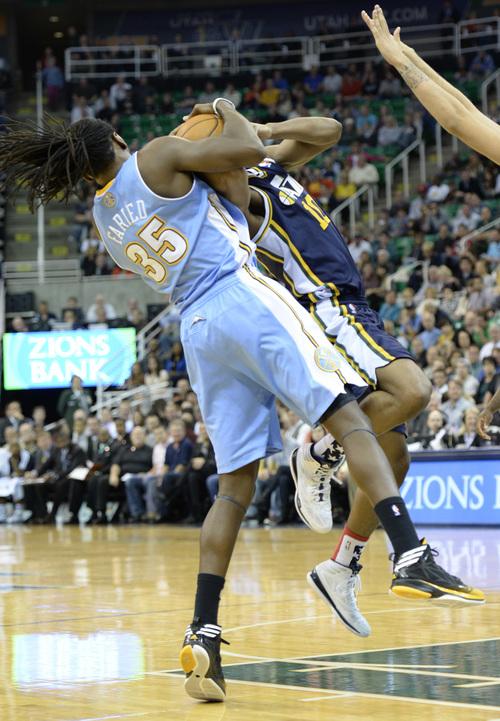 Rick Egan  | The Salt Lake Tribune   Utah Jazz point guard Alec Burks (10) is fouled by Denver Nuggets power forward Kenneth Faried (35) tries to work the ball inside, in NBA action, Utah vs. The Denver Nuggets, in Salt Lake City, Monday, November 11, 2013.