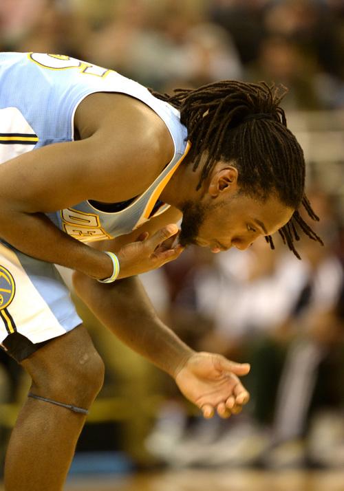 Rick Egan  | The Salt Lake Tribune   Denver Nuggets power forward Kenneth Faried (35) chokes after a previous play, in NBA action, Utah vs. The Denver Nuggets, in Salt Lake City, Monday, November 11, 2013.