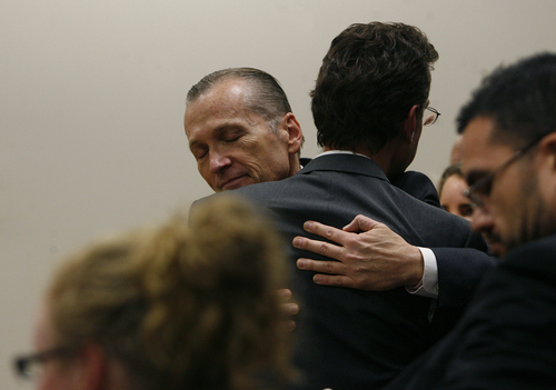 Scott Sommerdorf   |  The Salt Lake Tribune Martin MacNeill hugs attorney Randy Spencer as he thanks his defense team after he was found guilty of murder and obstruction of justice early Saturday morning, November 9, 2013.