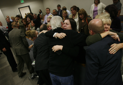 Scott Sommerdorf   |  The Salt Lake Tribune Alexis Somers, center, and other family members embrace after the court adjourned following the verdicts against Martin MacNeill were given. Martin MacNeill was found guilty of murder and obstruction of justice early Saturday morning, November 9, 2013.