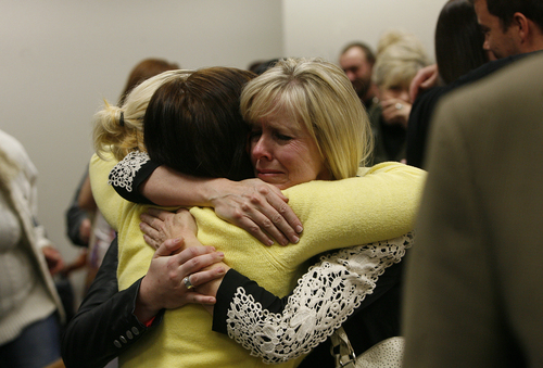 Scott Sommerdorf   |  The Salt Lake Tribune Linda Cluff, sister of Michele MacNeill hugs friends after court was adjourned following the guilty verdict against Martin MacNeill.MacNeill was found guilty of murder and obstruction of justice early Saturday morning, November 9, 2013.