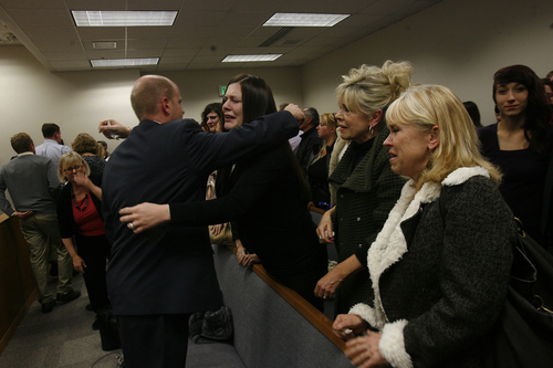 Scott Sommerdorf   |  The Salt Lake Tribune Alexis Somer, center, hugs prosecutor Chad Grunander  after the court adjourned following the verdicts against Martin MacNeill were given. Martin MacNeill was found guilty of murder and obstruction of justice early Saturday morning, November 9, 2013.