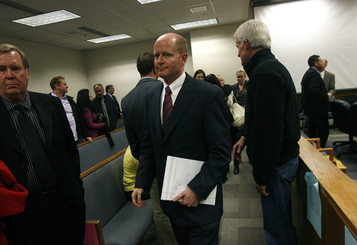 Scott Sommerdorf   |  The Salt Lake Tribune Prosecutor Chad Grunander leaves the court room after Martin McNeill was found guilty of murder and obstruction of justice early Saturday morning, November 9, 2013.