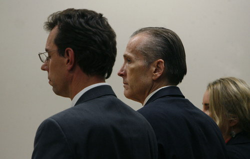 Scott Sommerdorf   |  The Salt Lake Tribune Martin MacNeill, listens as the guilty verdict was read on the count of murder. He was also found guilty of obstruction of justice early Saturday morning, November 9, 2013. MacNeill is flanked by his attorneys, Randy Spencer, left, and Susanne Gustin.
