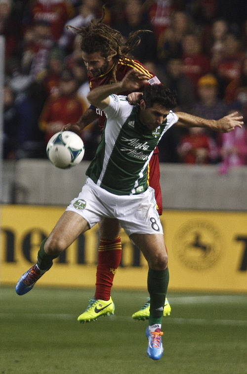 Leah Hogsten  |  The Salt Lake Tribune Real Salt Lake midfielder Kyle Beckerman (5) and Portland Timbers midfielder Will Johnson (4) take a header. Real Salt Lake leads the Portland Timbers 1-0 at the half during their first leg of  the Western Conference final series Sunday, November 10, 2013 at Rio Tinto Stadium.