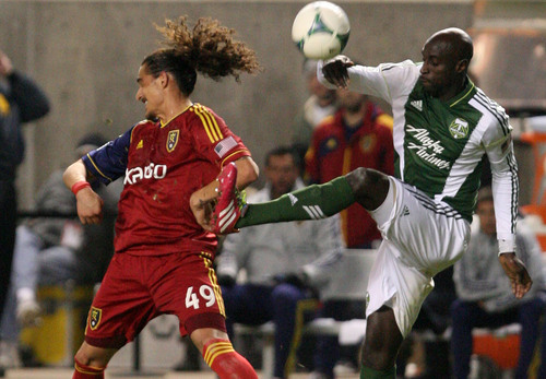Leah Hogsten  | The Salt Lake Tribune Real Salt Lake forward Devon Sandoval (49) and Portland Timbers defender Mamadou Danso (98) fight for possession. Real Salt Lake defeated the Portland Timbers 4-2  during their first leg of the Western Conference final series Sunday, November 10, 2013 at Rio Tinto Stadium.