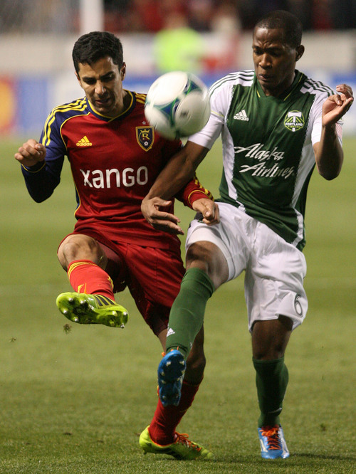 Leah Hogsten  | The Salt Lake Tribune Real Salt Lake defender Tony Beltran (2) and Portland Timbers forward/midfielder Darlington Nagbe (6) fight for possession. Real Salt Lake defeated the Portland Timbers 4-2  during their first leg of the Western Conference final series Sunday, November 10, 2013 at Rio Tinto Stadium.