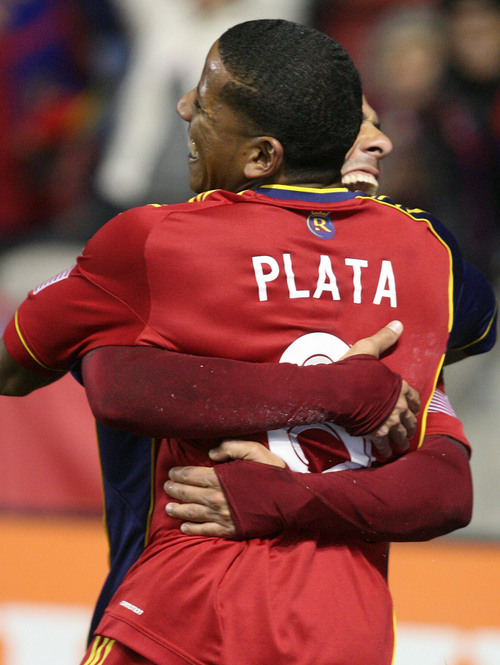 Leah Hogsten  | The Salt Lake Tribune Real Salt Lake midfielder Javier Morales (11) who headed the ball from teammate Real Salt Lake forward Jou Plata (8)celebrate the goal. Real Salt Lake defeated the Portland Timbers 4-2  during their first leg of the Western Conference final series Sunday, November 10, 2013 at Rio Tinto Stadium.